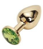 Золотистая анальная пробка с светло-зелёным кристаллом размера S - 7 см. - фото 250657